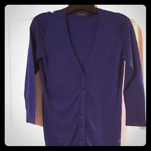 Very pretty blue v-neck button up in size small.
